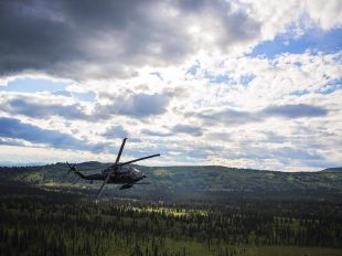 An Alaska Air National Guard HH-60 Pave Hawk, from the 210th Rescue Squadron, performs a simulated search and rescue pattern in Alaska. The 210th Rescue Squadron is part of a network of search-and-rescue organizations that save hundreds of lives in and around Alaska every year. Photo by Alaska National Guard