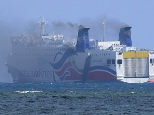 Smoke billowed from a fire on board the Caribbean Fantasy cruise ship off the coast of San Juan, Puerto Rico, on Wednesday. More than 500 passengers from the cruise ship were being evacuated by the U.S. Coast Guard. PHOTO: CARLOS GIUSTI/ASSOCIATED PRESS