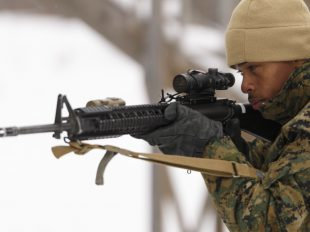 Photo By Sgt. Ian Leones | Lance Cpl. Samuel L. Posey, a rifleman with 3rd Platoon, Company I, 3rd Battalion, 25th Marine Regiment, 4th Marine Division, Marine Forces Reserve, sights in through his rifle while conducting room clearing drills during exercise Arctic Eagle at Camp Grayling, Mich., April 7, 2016. Posey overcame a rough childhood to become a Marine and serve his country. (U.S. Marine Corps photo by Sgt. Ian Leones/Released)