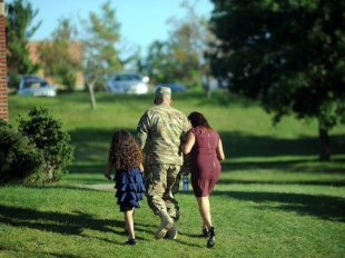 A soldier and his family depart a welcome home ceremony at Fort Drum in 2012. A bill supporting access to professional licensing for military spouses at Fort Drum and across New York is waiting on the approval of Gov. Andrew M. Cuomo.