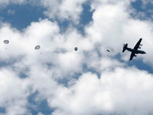 Photo by Sgt. William A. Battle | 372nd MPAD Soldiers from the Army Reserve's 861st Quartermaster Company jump out of a C­130 Saturday over Corregidor Drop Zone at Fort Campbell.
