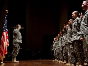 Sixty soldiers and non-commissioned officer Army Reservists are sworn in at the National Capitol Reenlistment Ceremony held in the Capitol Visitor Center. Photo by CQ Roll Call