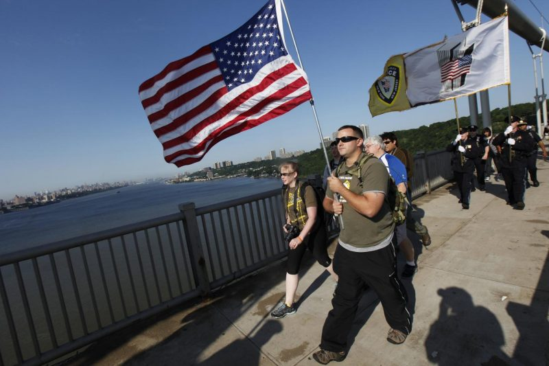 Iraq war veteran Troy Yocum and his wife Mareike walk across the George Washington Bridge June 15, 2011 to raise awareness about the severe problems U.S. military families face due to soldiers returning home from overseas deployment with post-traumatic stress disorder.