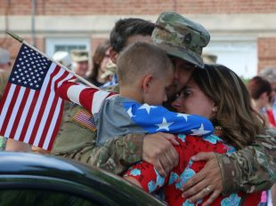 Family members bid farewell to Soldiers assigned to the Fort Belvoir-based 29th Infantry Division as they began federal active duty Aug. 1, 2016, at Fort Belvoir, Virginia. (Photo by Cotton Puryear, Virginia National Guard Public Affairs)