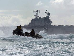 "Going ashore in rough seas is so disorienting that it can impair performance once on land. One solution is to fly in rotorcraft from ship to shore, but the vast majority of Marines will need surface ""connectors"" to get them and their vehicles close to the beach. (Wikimedia Commons/U.S. Navy released)"