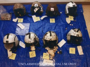 Eight helmets washed ashore in the days following the collision of two Marine Corps helicopters off the North Shore that killed 12 Marines. All showed severe structural damage.