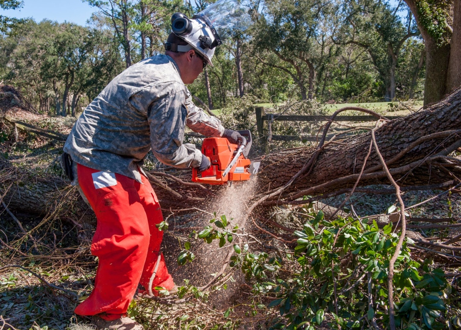 U.S. Army Sgt. Matthew McHenry with the 125th Multi-Role Bridge Company (MRBC), for the S.C. Army National Guard, uses a chainsaw to remove fallen trees along U.S. Highway 278 in Hilton Head Island, Oct. 9, 2016. Hurricane Matthew peaked as a Category 4 hurricane in the Caribbean and passed over the southeastern U.S., including the S.C. coast. Approximately 2,800 S.C. National Guard Soldiers and Airmen have been activated since Oct. 4, 2016, to support state and county emergency management agencies and local first responders after Governor Nikki Haley declared a State of Emergency.