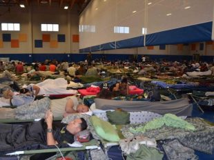 Guantánamo prison staff evacuated from trailer-park housing camped out Tuesday Oct. 4, 2016 in the base gym, far from the Detention Center Zone at the remote U.S. Navy base in Cuba, as shown in this Pentagon handout photo. Petty Officer Kegan Kay US NAVY