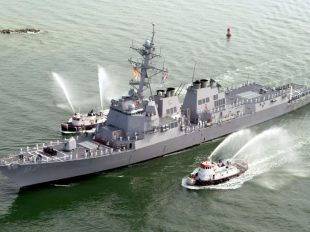 FILE PHOTO - The USS Mason (DDG 87), a guided missile destroyer, arrives at Port Canaveral, Florida, April 4, 2003. REUTERS/Karl Ronstrom/File photo