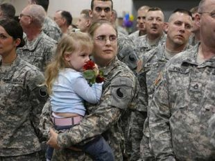 female-soldier-with-child