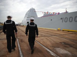 Sailors walk past the US Navy's new guided missile destroyer DDG 1000 USS Zumwalt on October 13, 2016 in Baltimore, Maryland. (Photo by Mark Wilson/Getty Images)