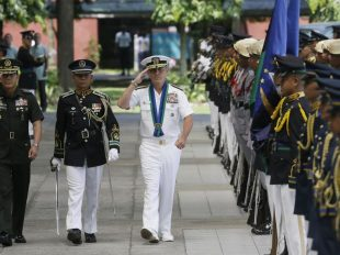 "U.S. Navy Admiral Harry B Harris, third from left, United States Pacific Command to the Philippines Commander (USPACOM), escorted by Philippine Armed Forces Chief Gen. Hernando Iriberri, left, salutes the colors during welcoming ceremony at the armed forces headquarters at suburban Quezon city northeast of Manila, Philippines Wednesday, Aug. 26, 2015. In the Armed Forces of the Philippines press statement, Admiral Harris is here for a two-day visit ""to discuss bilateral security concerns with the Philippines and gain local perspective on the security situation in the area of the Pacific region where the Philippines is located."" (AP Photo/Bullit Marquez)"