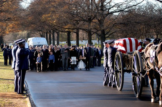 Air Force Honor Guardsmen transfer the casket carrying Air Force Maj. Troy Gilbert from the caisson to the grave site during a full honors funeral Dec. 11 at Arlington National Cemetery. Major Gilbert was the pilot of an Air Force F-16 Fighting Falcon engaged in support of coalition ground combat operations that crashed approximately 20 miles northwest of Baghdad Nov. 27. Major Gilbert was assigned to the 309th Fighter Squadron, Luke Air Force Base, Ariz., and was deployed to the 332nd Expeditionary Wing, Balad Air Base, Iraq. (U.S. Air Force photo/Maj. Francisco G. Hamm)