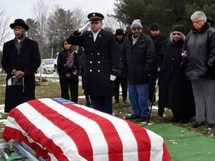 New York Army National Guard SPC Ramon Rodriquez renders a salute to Army Veteran Osborne Haynes.