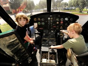 Mason Filstrup, 6, and his brother Jackson Filstrup, 4, of Pleasant Hill, explore the inside of a military helicopter during VetCon 2015, a one-day resource fair for veterans and their families in Concord.A former Air Force parent argues that military children especially need consistent and high education standards to flourish. (Susan Tripp Pollard/Bay Area News Group)