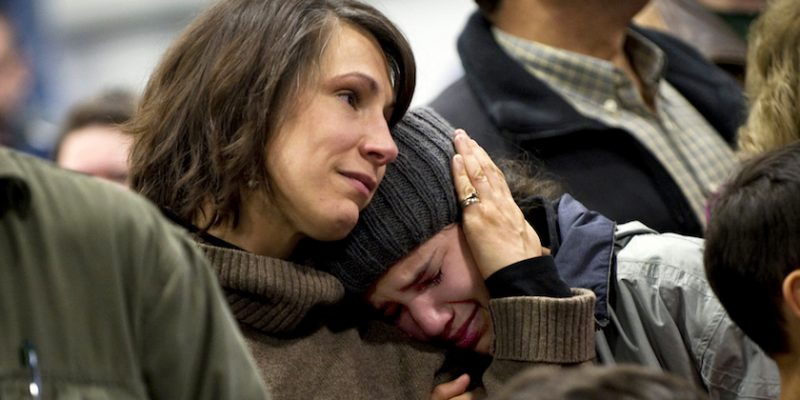 A family cries while watching the departure of the 86th Infantry Brigade Combat Team depart after their deployment ceremony in Burlington, Vt. on Jan. 8, 2010. DoD photo by U.S. Navy Petty Officer 1st Class Chad J. McNeeley.