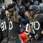Army running back Andy Davidson (40) celebrates his touchdown with teammates in the first half of the Army-Navy NCAA college football game in Baltimore, Saturday, Dec. 10, 2016. (Patrick Semansky/Associated Press)