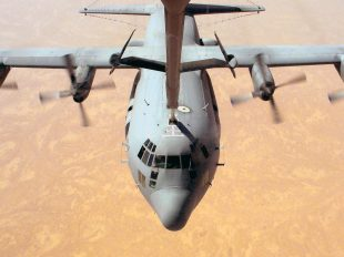 OPERATION IRAQI FREEDOM (AFPN) -- An EC-130H Compass Call aircraft from the 41st Expeditionary Electronic Combat Squadron refuels while flying a mission over Iraq during Operation Iraqi Freedom.  Squadron airmen will return home soon to Davis-Monthan Air Force Base, Ariz.  (U.S Air Force photo by Master Sgt. Luis Drummond)