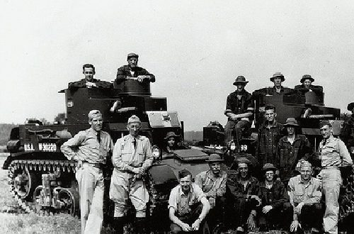 Members of Company D, 192nd Tank Battalion, Kentucky National Guard, pose with their vehicles at Ft. Knox, Ky., during the unit's training prior to World War II. Called into federal service pursuant to the national emergency declared by President Franklin D. Roosevelt in 1940, the 192nd, along with the Guard's 194th Tank Battalion, were deployed to reinforce the Army garrison of the Philippines. Photo By: Kentucky National Guard