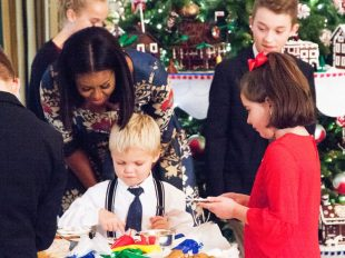 First Lady Michelle Obama admires a boy's decorating of a cookie at the White House on Nov. 29, 2016. Obama invited military families to the White House to preview holiday decorations. C.J. Lin/Stars and Stripes