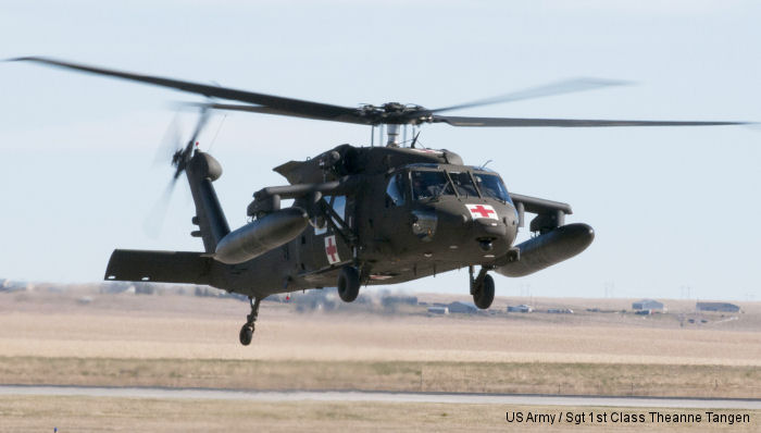 A new South Dakota Army National Guard HH-60M Black Hawk helicopter hovers before landing at the Army Aviation Support Facility in Rapid City, S.D., Oct. 29, 2014. The SDARNG has received its first two of six aircraft, which will replace its current inventory of six UH-60 A/L model Black Hawk helicopters. The new aircraft will provide an increased operational capability to support state and federal missions. (U.S. Army National Guard photo by Sgt. 1st Class Theanne Tangen/Released)