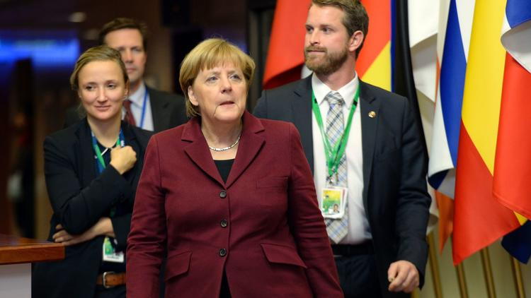 German Chancellor Angela Merkel, center, departs the European Union summit in Brussels. (Thierry Charlier / AFP/Getty Images)