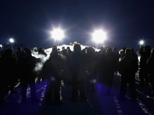 Military veterans, most of whom are native American, confront police guarding a bridge near Oceti Sakowin Camp on the edge of the Standing Rock Sioux Reservation on November 30, 2016 outside Cannon Ball, North Dakota Getty Images