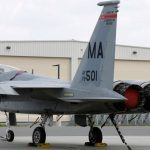 In this Aug. 27, 2014, file photo, a Massachusetts Air National Guard F-15C fighter aircraft sits near a hangar at Barnes Air National Guard Base, in Westfield, Mass  (AP Photo/Steven Senne)