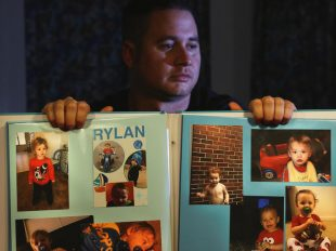 Corey Ott displays a book of photographs of his son, Rylan Ott, who apparently drowned in a North Carolina pond while under the care of his mother, Samantha Bryant. (Rick Loomis/Los Angeles Times/TNS)