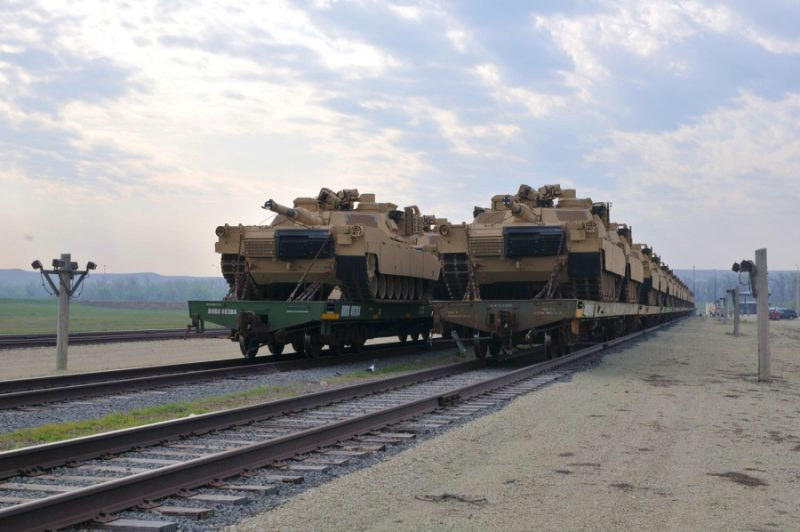 "Several dozen of the Army's ""newest"" Abrams tanks wait to be offloaded from flatbed train cars in 2012 at Fort Riley's Railhead. A recent Congressional Research Service report said the automatic-loading 125-mm guns on the Chinese MBT-3000 and the Russian T-14 Armata could ""theoretically offer greater range and armor penetration"" than the American 120-mm."