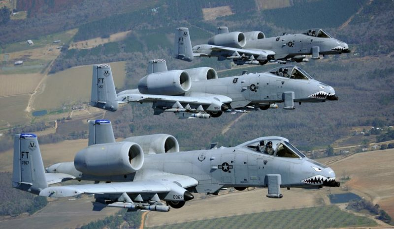 Three A-10C Thunderbolt II aircraft from the 74th and 75th Fighter Squadrons out of Moody Air Force Base, Ga., fly in formation during a training session here March 16, 2010. These A-10 pilots flew in several different formations