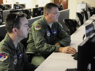 U.S. Air Force members of the 217th Air Operations Group conduct command and control exercises during Northern Strike 2014 at the Battle Creek Air National Guard Base, Michigan, Thursday, August 14, 2014. Northern Strike 2014, a three week event from August 4-22, 2014 includes twenty-Four units from 12 states and two Coalition partners. The event takes place primarily at Alpena Combat Readiness Training Center and Camp Grayling Joint Maneuver Training Center. Over 300 Total Force Fighter, bomber, mobility, and rotary sorties planned in support of live fire exercises in order to meet stated objectives for participating units. (Air National Guard Photos by Master Sgt. Sonia Pawloski/Released)