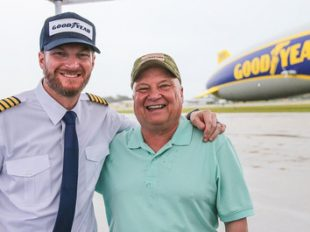 Dale Earnhardt Jr. surprises military veteran and racing fan Paul Siverson in the Goodyear Blimp near Daytona Beach, Fla., Wednesday, February 22, 2017. (Gary Lloyd McCullough  for Goodyear)