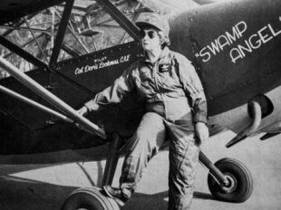 "Doris Lockness stands next to her Vultee-Stinson warbird, dubbed ""Swamp Angel."" (Lockness family)"