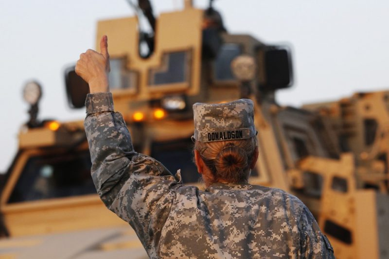 U.S. Army convoys are given the thumbs up from a fellow soldier after crossing into Kuwait during the last convoy out of Iraq December 18, 2011