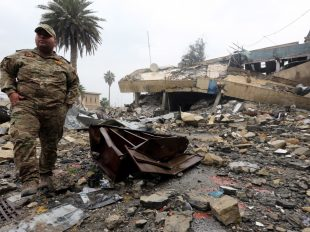 An Iraqi soldier inspects a destroyed building that was used by the Islamic state in Mosul. (Ahmed Jalil/European Pressphoto Agency)