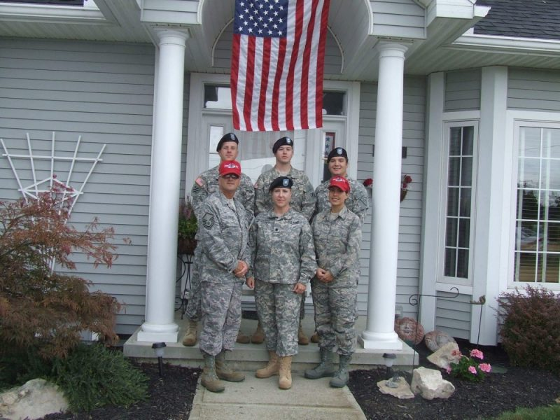 Courtesy Photo | Members of the Clemens Family, with more than 120 years of military service, stand in front of the Family home in Port Clinton after three of them returned from overseas deployments. Pictured are retired Senior Master Sgt. Ken Clemens (clockwise from front row, left), Col. Barb Herrington-Clemens, Capt. Chelsea Migura, Staff Sgt. Rich Clemens, Staff Sgt. Drew Clemens and Sgt. 1st Class Zach Migura. (Courtesy photo)