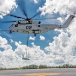U.S. Marine Corps pilots maneuver a CH-53K King Stallion as it delivers a 12,000 pound external load after completing a 110 nautical mile mission during the two-week initial operational test (OT-B1) conducted at Sikorsky. Sikorsky photo.