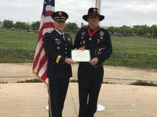 In this Monday, March 20, 2017, photo provided by the California Army National Guard, former Army Maj. Gen. Juilian Burns, left, presents retired U.S. Army Sgt. Joseph Engles with the Bronze Star during a ceremony in his hometown of Murrieta, Calif. Engles received the honor for gallantry in the face of the enemy during the Battle of Suoi Tre, Vietnam in March 1967. (Capt. Will Martin/California Army National Guard via AP)  (The Associated Press)