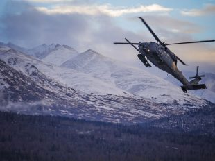 "An HH-60 Pave Hawk helicopter from the 210th Rescue Squadron, Alaska Air National Guard, practices ""touch and go"" maneuvers at Bryant Army Airfield on Joint Base Elmendorf-Richardson, Dec. 17, 2014. (U.S. Army National Guard photo by Sgt. Edward Eagerton)"