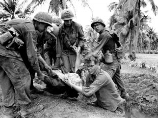 American soldiers with a wounded comrade after a battle near Bong Son, Vietnam, in March 1967. Credit Dana Stone/Associated Press
