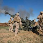 US Marines fire artillery to break up ISIS fighters attacking Kurdish and Peshmerga forces. Cpl. Andre Dakis/US Marine Corps