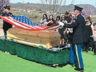 Sgt. 1st Class Shawn Fidler (left) and Sgt. Nick Gonzales of the Nevada Army National Guard's Southern Nevada Honor Guard Team fold an American flag for the family of former Arizona Army National Guardsman Roger Esquerra during a service March 10.