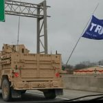 A Trump flag is seen flying from the lead vehicle in a military convoy driving through Kentucky in January. (Indivisible Kentucky / Washington Post)