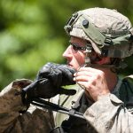 An infantryman with A Company, 1st Battalion, 151st Infantry Regiment, 76th Infantry Brigade, Indiana Army National Guard puts on his Advanced Combat Helmet in preparation for a patrol for mock enemy troops during a training exercise at Camp Atterbury, Indiana, Aug. 8, 2016. JARRED WOODS/U.S. ARMY