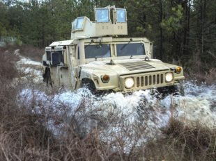 U.S. Marines drive Humvees through the Combat Vehicle Operators Training Course on Camp Lejeune, N.C., Dec. 6, 2016. Five people have been charged in a $6 million scheme to overcharge the Defense Department for Humvee window frames. TYLER W. STEWART/U.S. MARINE CORPS