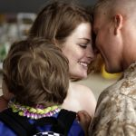 Savannah Dejong holding her son Rhone (3) greets her husband, Daniel with 1/3 Marines Bravo Company, upon his return to Hawaii on June 13, 2010, following a seven-month deployment in southern Afghanistan. AFP PHOTO/PATRICK BAZ (Photo credit should read PATRICK BAZ/AFP/Getty Images)