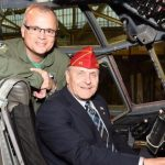 American Legion national commander Charles Schmidt sits in the pilot's seat of a C-130 aircraft next to 914th Airlift Wing commander Col. Brian Bowman at the Niagara Falls Air Reserve Station, N.Y. in late 2016. (photo courtesy of U.S. Air Force)
