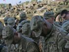 Soldiers from 2nd Squadron, 2nd Cavalry Regiment, bow their heads in prayer in preparation for Operation Atlantic Resolve's Cavalry March, May 13, 2015. Army photo
