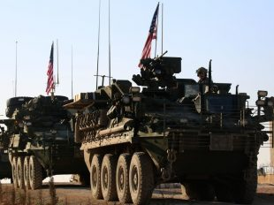A convoy of US armored vehicles drove near the outskirts of Manbij, Syria on March 5. Delil Souleiman / AFP / Getty Images